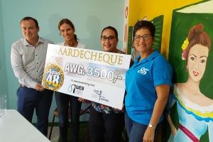 Di shete donacion di Aqua48 a bay pa Fundacion Ambiente Feliz
