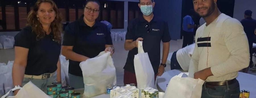 Kiwanis Club of Aruba a parti paketenan di cuminda pa 141 famia