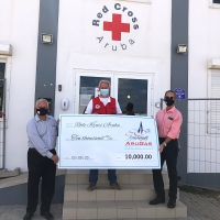 Cruz Cora a ricibi donacion generoso di compania di utilidad