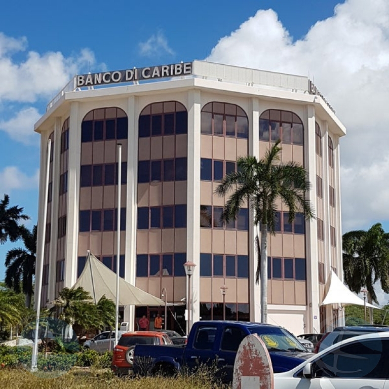 Lo bende Banco di Caribe cu United Group Holdings NV